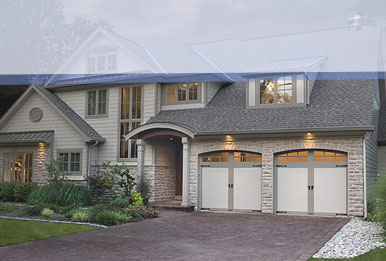 Residential home with lights over the garage doors